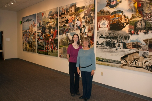 Stephanie Flint and Dr. Bonsall in front of the Warrensburg Mural